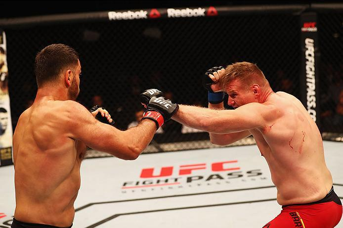 HAMBURG, GERMANY - SEPTEMBER 03:  Josh Barnett (R) of USA punches Andrei Arlovski (L) of Belarus compete in their Heavyweight Bout during the UFC Fight Night held at Barclaycard Arena  at Barclaycard Arena on September 3, 2016 in Hamburg, Germany.  (Photo