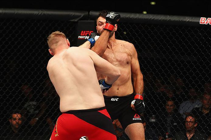 HAMBURG, GERMANY - SEPTEMBER 03:  Josh Barnett (L) of USA and Andrei Arlovski (R) of Belarus compete in their Heavyweight Bout during the UFC Fight Night held at Barclaycard Arena  at Barclaycard Arena on September 3, 2016 in Hamburg, Germany.  (Photo by