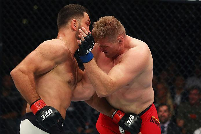 HAMBURG, GERMANY - SEPTEMBER 03:  Josh Barnett (R) of USA and Andrei Arlovski (L) of Belarus compete in their Heavyweight Bout during the UFC Fight Night held at Barclaycard Arena  at Barclaycard Arena on September 3, 2016 in Hamburg, Germany.  (Photo by