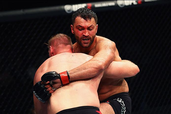 HAMBURG, GERMANY - SEPTEMBER 03:  Josh Barnett (L) of USA controls the body of Andrei Arlovski (R) of Belarus compete in their Heavyweight Bout during the UFC Fight Night held at Barclaycard Arena  at Barclaycard Arena on September 3, 2016 in Hamburg, Ger