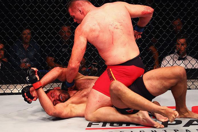 HAMBURG, GERMANY - SEPTEMBER 03:  Josh Barnett (top) of USA controls the body of Andrei Arlovski (L) of Belarus compete in their Heavyweight Bout during the UFC Fight Night held at Barclaycard Arena  at Barclaycard Arena on September 3, 2016 in Hamburg, G