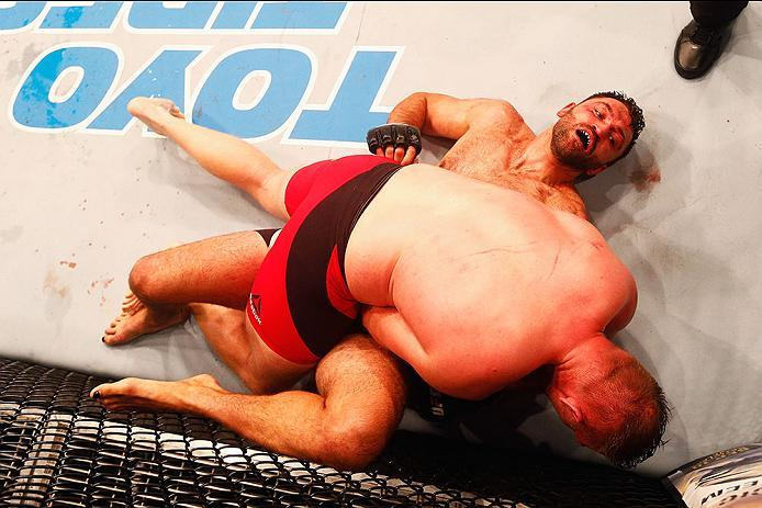 HAMBURG, GERMANY - SEPTEMBER 03:  Josh Barnett (top) of USA controls the body of  Andrei Arlovski  of Belarus compete in their Heavyweight Bout during the UFC Fight Night held at Barclaycard Arena  at Barclaycard Arena on September 3, 2016 in Hamburg, Ger