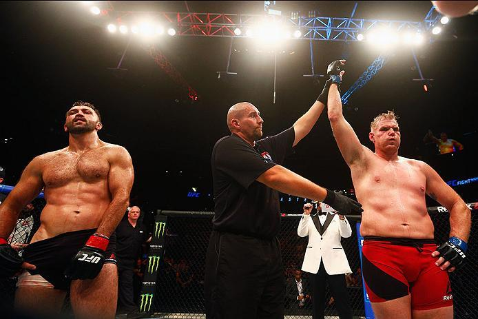 HAMBURG, GERMANY - SEPTEMBER 03:   Josh Barnett (R) of USA celebrates his victory over Andrei Arlovski (L) of Belarus in their Heavyweight Bout during the UFC Fight Night held at Barclaycard Arena  at Barclaycard Arena on September 3, 2016 in Hamburg, Ger