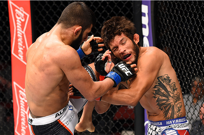 HOLLYWOOD, FL - JUNE 27:   (L-R) Sirwan Kakai of Sweden lands a knee to the head of Danny Martinez in their bantamweight during the UFC Fight Night event at the Hard Rock Live on June 27, 2015 in Hollywood, Florida. (Photo by Josh Hedges/Zuffa LLC/Zuffa L