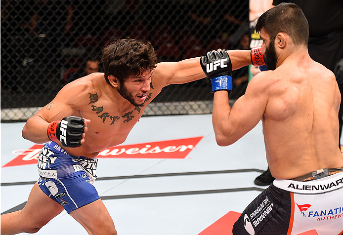 HOLLYWOOD, FL - JUNE 27:   (L-R) Danny Martinez punches Sirwan Kakai of Sweden in their bantamweight during the UFC Fight Night event at the Hard Rock Live on June 27, 2015 in Hollywood, Florida. (Photo by Josh Hedges/Zuffa LLC/Zuffa LLC via Getty Images)