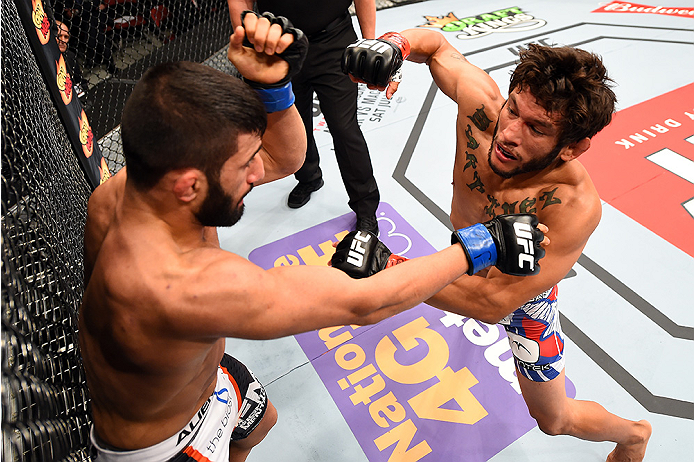 HOLLYWOOD, FL - JUNE 27:   (R-L) Danny Martinez punches Sirwan Kakai of Sweden in their bantamweight during the UFC Fight Night event at the Hard Rock Live on June 27, 2015 in Hollywood, Florida. (Photo by Josh Hedges/Zuffa LLC/Zuffa LLC via Getty Images)