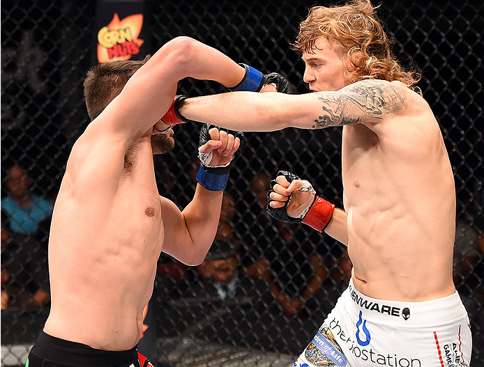 HOLLYWOOD, FL - JUNE 27:  (R-L) Steve Montgomery punches Tony Sims in their welterweight during the UFC Fight Night event at the Hard Rock Live on June 27, 2015 in Hollywood, Florida. (Photo by Josh Hedges/Zuffa LLC/Zuffa LLC via Getty Images)