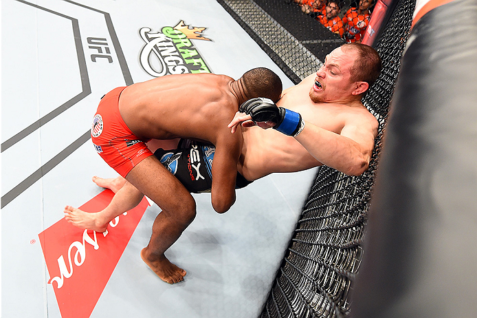 HOLLYWOOD, FL - JUNE 27:   (L-R) Leandro Silva of Brazil takes down Lewis Gonzalez in their welterweight during the UFC Fight Night event at the Hard Rock Live on June 27, 2015 in Hollywood, Florida. (Photo by Josh Hedges/Zuffa LLC/Zuffa LLC via Getty Ima