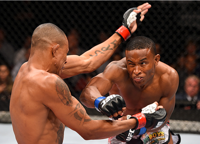 HOLLYWOOD, FL - JUNE 27:   (R-L) Joe Merritt punches Alex Oliveira of Brazil in their welterweight during the UFC Fight Night event at the Hard Rock Live on June 27, 2015 in Hollywood, Florida. (Photo by Josh Hedges/Zuffa LLC/Zuffa LLC via Getty Images)