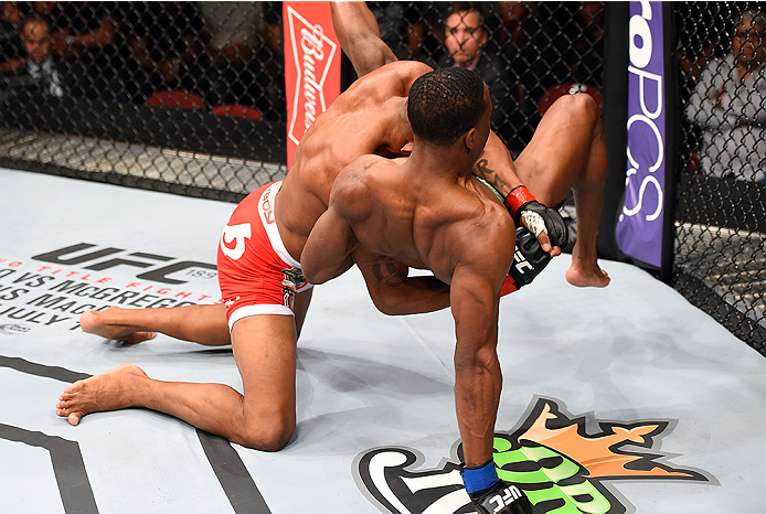 HOLLYWOOD, FL - JUNE 27:   (L-R) Alex Oliveira of Brazil takes down Joe Merritt in their welterweight during the UFC Fight Night event at the Hard Rock Live on June 27, 2015 in Hollywood, Florida. (Photo by Josh Hedges/Zuffa LLC/Zuffa LLC via Getty Images