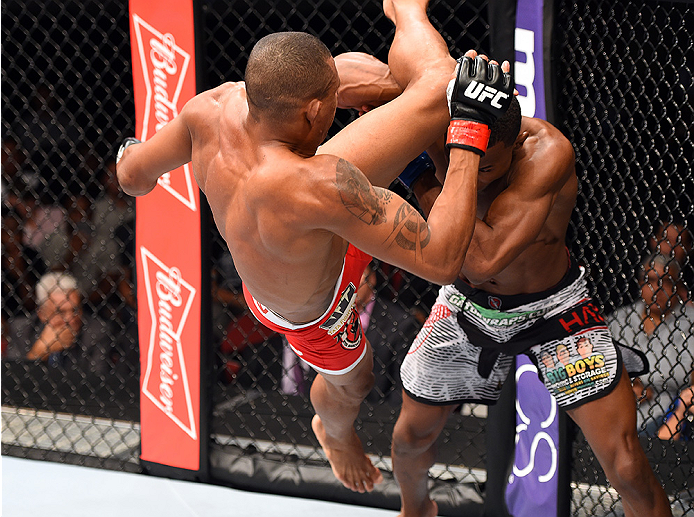 HOLLYWOOD, FL - JUNE 27:   (L-R) Alex Oliveira of Brazil throws a flying knee against Joe Merritt in their welterweight during the UFC Fight Night event at the Hard Rock Live on June 27, 2015 in Hollywood, Florida. (Photo by Josh Hedges/Zuffa LLC/Zuffa LL