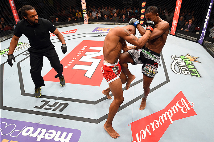 HOLLYWOOD, FL - JUNE 27:  (R-L) Joe Merritt lands a knee to the body of Alex Oliveira of Brazil in their welterweight during the UFC Fight Night event at the Hard Rock Live on June 27, 2015 in Hollywood, Florida. (Photo by Josh Hedges/Zuffa LLC/Zuffa LLC