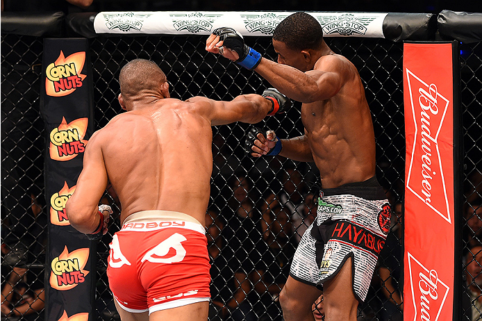 HOLLYWOOD, FL - JUNE 27:  (L-R) Alex Oliveira of Brazil punches Joe Merritt in their welterweight during the UFC Fight Night event at the Hard Rock Live on June 27, 2015 in Hollywood, Florida. (Photo by Josh Hedges/Zuffa LLC/Zuffa LLC via Getty Images)