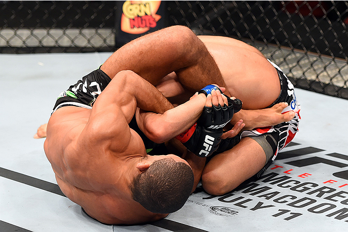 HOLLYWOOD, FL - JUNE 27:  (L-R) Hacran Dias of Brazil attempts a submission against Levan Makashvili in their featherweight during the UFC Fight Night event at the Hard Rock Live on June 27, 2015 in Hollywood, Florida. (Photo by Josh Hedges/Zuffa LLC/Zuff