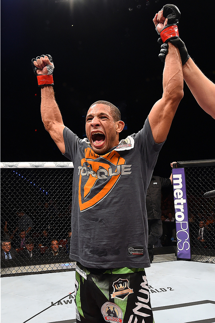 HOLLYWOOD, FL - JUNE 27:  Hacran Dias of Brazil celebrates after defeating Levan Makashvili in their featherweight during the UFC Fight Night event at the Hard Rock Live on June 27, 2015 in Hollywood, Florida. (Photo by Josh Hedges/Zuffa LLC/Zuffa LLC via