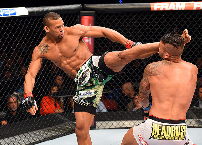 HOLLYWOOD, FL - JUNE 27:   (L-R) Thiago Santos of Brazil lands a kick to the head of Steve Bosse of Canada in their middleweight during the UFC Fight Night event at the Hard Rock Live on June 27, 2015 in Hollywood, Florida. (Photo by Josh Hedges/Zuffa LLC