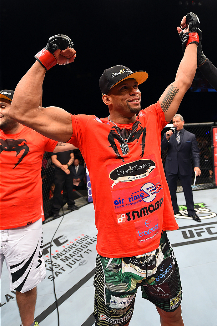 HOLLYWOOD, FL - JUNE 27:   Thiago Santos of Brazil celebrates after defeating Steve Bosse of Canada in their middleweight during the UFC Fight Night event at the Hard Rock Live on June 27, 2015 in Hollywood, Florida. (Photo by Josh Hedges/Zuffa LLC/Zuffa