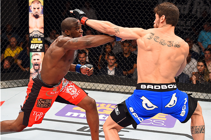 HOLLYWOOD, FL - JUNE 27:   (L-R) Eddie Gordon punches Antonio Carlos Junior of Brazil in their middleweight during the UFC Fight Night event at the Hard Rock Live on June 27, 2015 in Hollywood, Florida. (Photo by Josh Hedges/Zuffa LLC/Zuffa LLC via Getty