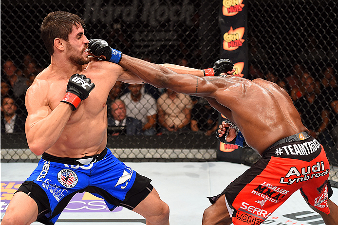 HOLLYWOOD, FL - JUNE 27:  (L-R) Antonio Carlos Junior of Brazil punches Eddie Gordon in their middleweight during the UFC Fight Night event at the Hard Rock Live on June 27, 2015 in Hollywood, Florida. (Photo by Josh Hedges/Zuffa LLC/Zuffa LLC via Getty I