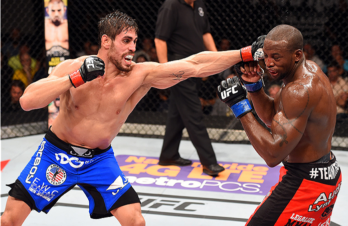HOLLYWOOD, FL - JUNE 27:   (L-R) Antonio Carlos Junior of Brazil punches Eddie Gordon in their middleweight during the UFC Fight Night event at the Hard Rock Live on June 27, 2015 in Hollywood, Florida. (Photo by Josh Hedges/Zuffa LLC/Zuffa LLC via Getty