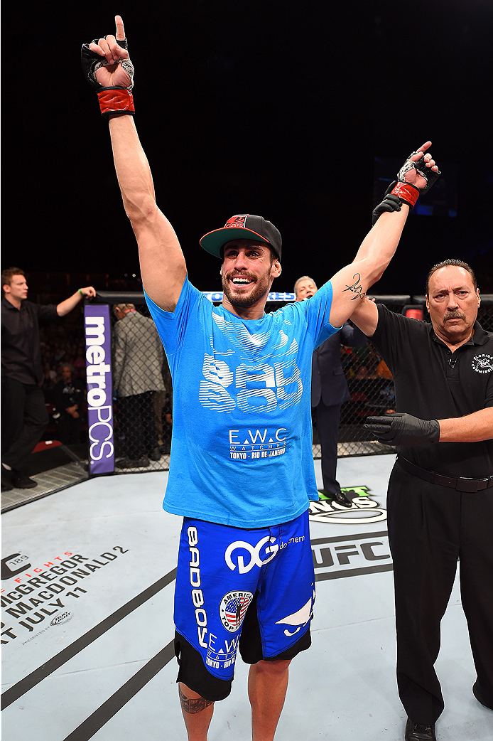 HOLLYWOOD, FL - JUNE 27:   Antonio Carlos Junior of Brazil celebrates after defeating Eddie Gordon in their middleweight during the UFC Fight Night event at the Hard Rock Live on June 27, 2015 in Hollywood, Florida. (Photo by Josh Hedges/Zuffa LLC/Zuffa L