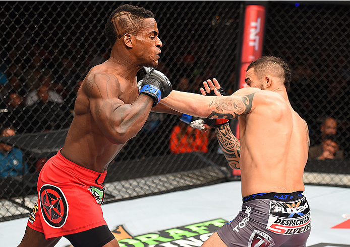 HOLLYWOOD, FL - JUNE 27:   (L-R) Lorenz Larkin punches Santiago Ponzinibbio of Argentina in their welterweight during the UFC Fight Night event at the Hard Rock Live on June 27, 2015 in Hollywood, Florida. (Photo by Josh Hedges/Zuffa LLC/Zuffa LLC via Get