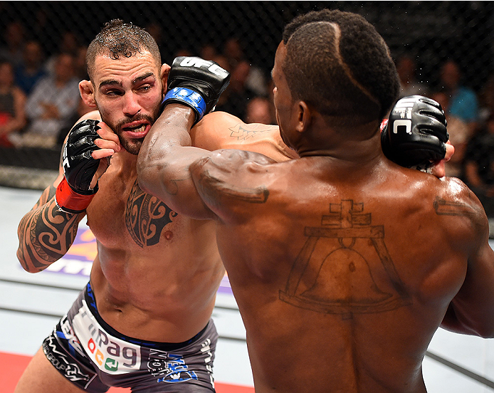 HOLLYWOOD, FL - JUNE 27:  (L-R) Santiago Ponzinibbio of Argentina punches Lorenz Larkin in their welterweight during the UFC Fight Night event at the Hard Rock Live on June 27, 2015 in Hollywood, Florida. (Photo by Josh Hedges/Zuffa LLC/Zuffa LLC via Gett