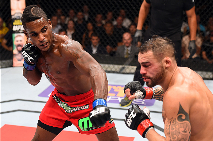 HOLLYWOOD, FL - JUNE 27:  (L-R) Lorenz Larkin punches Santiago Ponzinibbio of Argentina in their welterweight during the UFC Fight Night event at the Hard Rock Live on June 27, 2015 in Hollywood, Florida. (Photo by Josh Hedges/Zuffa LLC/Zuffa LLC via Gett