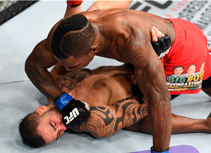 HOLLYWOOD, FL - JUNE 27:  (R-L) Lorenz Larkin punches Santiago Ponzinibbio of Argentina in their welterweight during the UFC Fight Night event at the Hard Rock Live on June 27, 2015 in Hollywood, Florida. (Photo by Josh Hedges/Zuffa LLC/Zuffa LLC via Gett