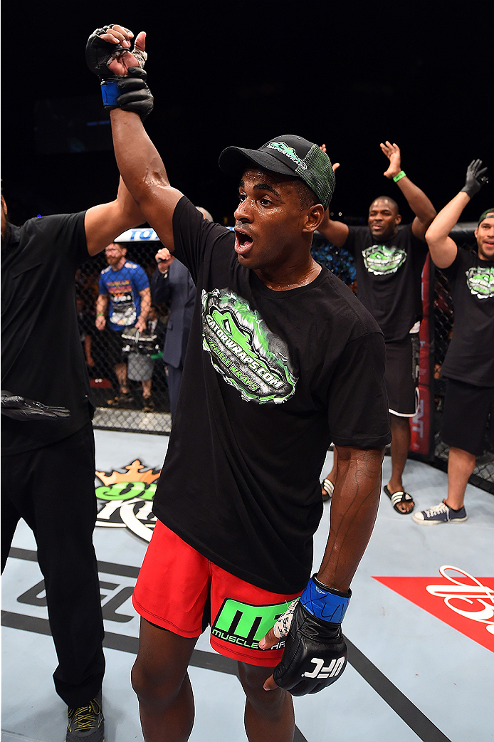 HOLLYWOOD, FL - JUNE 27:   Lorenz Larkin celebrates after defeating Santiago Ponzinibbio of Argentina in their welterweight during the UFC Fight Night event at the Hard Rock Live on June 27, 2015 in Hollywood, Florida. (Photo by Josh Hedges/Zuffa LLC/Zuff
