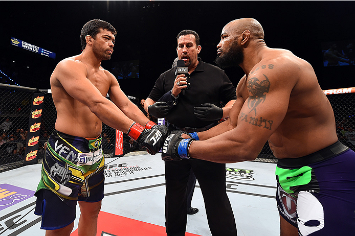 HOLLYWOOD, FL - JUNE 27:   (L-R) Lyoto Machida of Brazil and Yoel Romero of Cuba touch gloves before their middleweight during the UFC Fight Night event at the Hard Rock Live on June 27, 2015 in Hollywood, Florida. (Photo by Josh Hedges/Zuffa LLC/Zuffa LL