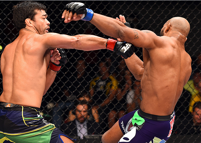 HOLLYWOOD, FL - JUNE 27:   (L-R) Lyoto Machida punches Yoel Romero in their middleweight during the UFC Fight Night event at the Hard Rock Live on June 27, 2015 in Hollywood, Florida. (Photo by Josh Hedges/Zuffa LLC/Zuffa LLC via Getty Images)