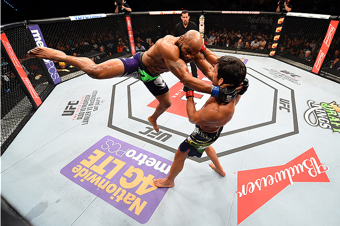 HOLLYWOOD, FL - JUNE 27:  (L-R) Yoel Romero of Cuba lunges at Lyoto Machida of Brazil in their middleweight during the UFC Fight Night event at the Hard Rock Live on June 27, 2015 in Hollywood, Florida. (Photo by Josh Hedges/Zuffa LLC/Zuffa LLC via Getty