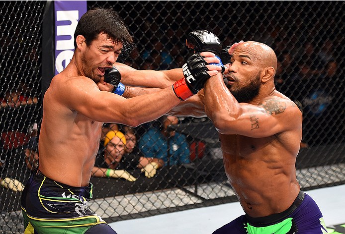 HOLLYWOOD, FL - JUNE 27:  (R-L) Yoel Romero of Cuba punches Lyoto Machida of Brazil in their middleweight during the UFC Fight Night event at the Hard Rock Live on June 27, 2015 in Hollywood, Florida. (Photo by Josh Hedges/Zuffa LLC/Zuffa LLC via Getty Im