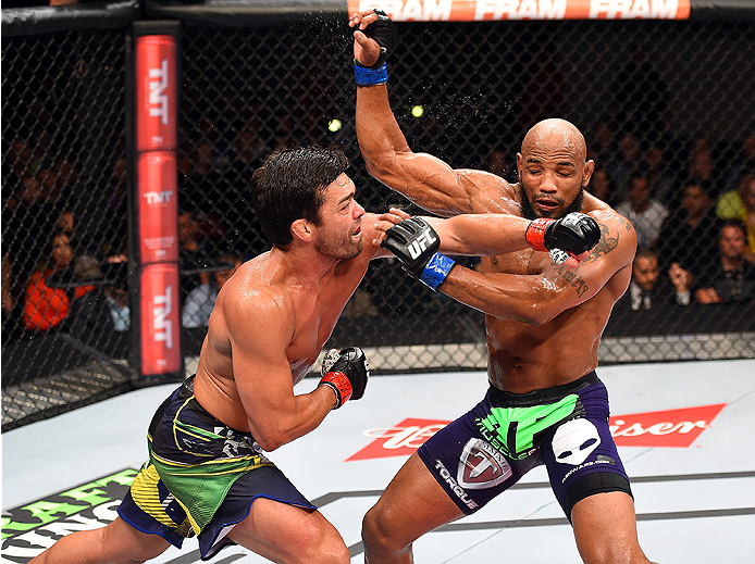 HOLLYWOOD, FL - JUNE 27:  (L-R) Lyoto Machida of Brazil punches Yoel Romero of Cuba in their middleweight during the UFC Fight Night event at the Hard Rock Live on June 27, 2015 in Hollywood, Florida. (Photo by Josh Hedges/Zuffa LLC/Zuffa LLC via Getty Im