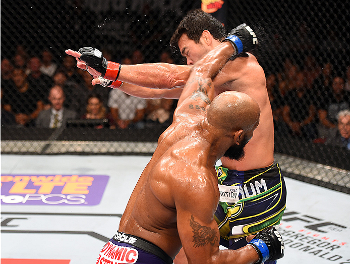 HOLLYWOOD, FL - JUNE 27:  (L-R) Yoel Romero of Cuba punches Lyoto Machida of Brazil in their middleweight during the UFC Fight Night event at the Hard Rock Live on June 27, 2015 in Hollywood, Florida. (Photo by Josh Hedges/Zuffa LLC/Zuffa LLC via Getty Im