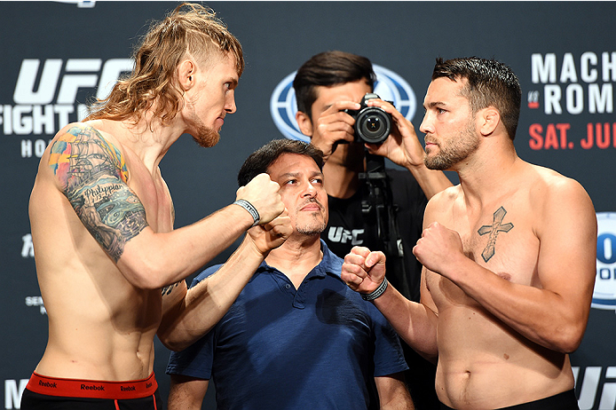 HOLLYWOOD, FL - JUNE 26:  (L-R) Steve Montgomery and Tony Sims face off during the UFC weigh-in at the Seminole Hard Rock Casino on June 26, 2015 in Hollywood, Florida. (Photo by Josh Hedges/Zuffa LLC/Zuffa LLC via Getty Images)