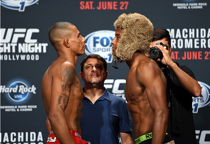 HOLLYWOOD, FL - JUNE 26:   (L-R) Alex Oliveira of Brazil and Joe Merritt face-off during the UFC weigh-in at the Seminole Hard Rock Casino on June 26, 2015 in Hollywood, Florida. (Photo by Josh Hedges/Zuffa LLC/Zuffa LLC via Getty Images)