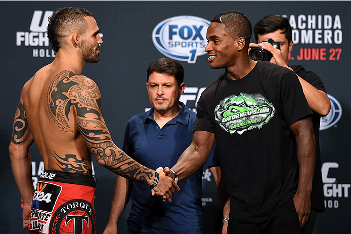 HOLLYWOOD, FL - JUNE 26:   (L-R) Santiago Ponzinibbio of Argentina shakes hands with opponent Lorenz Larkin during the UFC weigh-in at the Seminole Hard Rock Casino on June 26, 2015 in Hollywood, Florida. (Photo by Josh Hedges/Zuffa LLC/Zuffa LLC via Gett