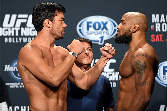 HOLLYWOOD, FL - JUNE 26:  (L-R) Lyoto Machida of Brazil and Yoel Romero of Cuba face-off during the UFC weigh-in at the Seminole Hard Rock Casino on June 26, 2015 in Hollywood, Florida. (Photo by Josh Hedges/Zuffa LLC/Zuffa LLC via Getty Images)