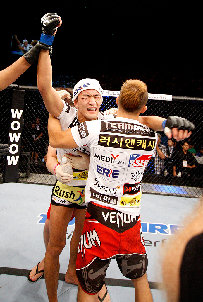 SAITAMA, JAPAN - SEPTEMBER 20: Kyung Ho Kang celebrates his win over Michinori Tanaka  in their bantamweight bout during the UFC Fight Night event inside the Saitama Arena on September 20, 2014 in Saitama, Japan. (Photo by Mitch Viquez/Zuffa LLC/Zuffa LLC