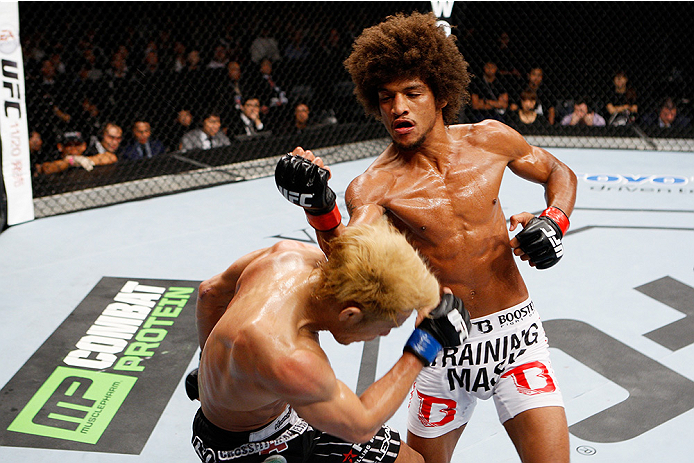 SAITAMA, JAPAN - SEPTEMBER 20:  Alex Caceres and Masanori Kanehara exchange a fury of punches in their bantamweight bout during the UFC Fight Night event inside the Saitama Arena on September 20, 2014 in Saitama, Japan. (Photo by Mitch Viquez/Zuffa LLC/Zu