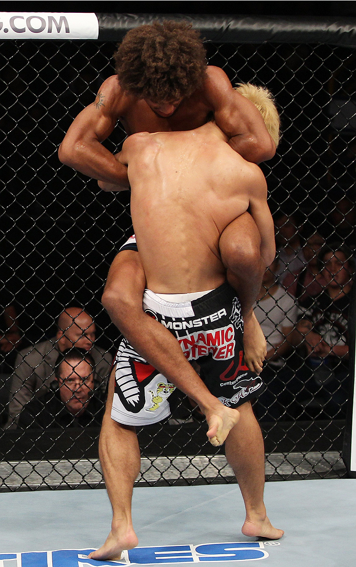 SAITAMA, JAPAN - SEPTEMBER 20:  Alex Caceres goes for a submission on Masanori Kanehara in their bantamweight bout during the UFC Fight Night event inside the Saitama Arena on September 20, 2014 in Saitama, Japan. (Photo by Mitch Viquez/Zuffa LLC/Zuffa LL