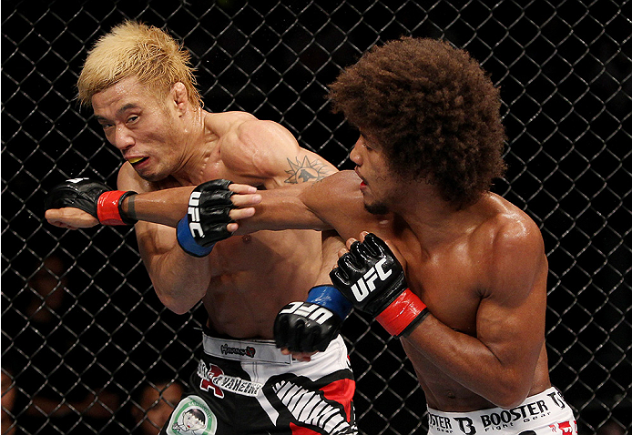 SAITAMA, JAPAN - SEPTEMBER 20: Alex Caceres throws a punch at Masanori Kanehara in their bantamweight bout during the UFC Fight Night event inside the Saitama Arena on September 20, 2014 in Saitama, Japan. (Photo by Mitch Viquez/Zuffa LLC/Zuffa LLC via Ge