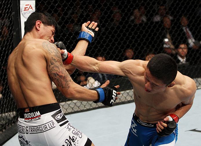 SAITAMA, JAPAN - SEPTEMBER 20:  Kyoji Horiguchi punches Jon Delos Reyes in their flyweight bout during the UFC Fight Night event inside the Saitama Arena on September 20, 2014 in Saitama, Japan. (Photo by Mitch Viquez/Zuffa LLC/Zuffa LLC via Getty Images)