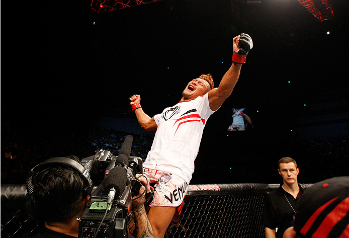 SAITAMA, JAPAN - SEPTEMBER 20:  Kiichi Kunimoto celebrates after his win over Richard Walsh in their welterweight bout during the UFC Fight Night event inside the Saitama Arena on September 20, 2014 in Saitama, Japan. (Photo by Mitch Viquez/Zuffa LLC/Zuff