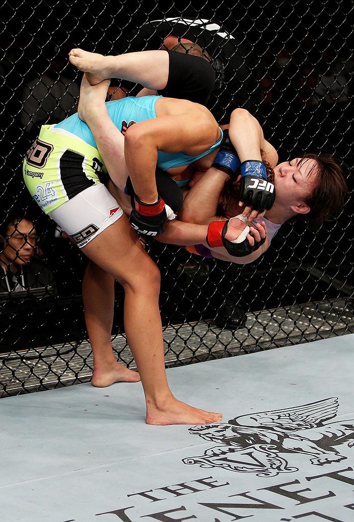 SAITAMA, JAPAN - SEPTEMBER 20:  Rin Nakai hangs from Miesha Tate in their bantamweight bout during the UFC Fight Night event inside the Saitama Arena on September 20, 2014 in Saitama, Japan. (Photo by Mitch Viquez/Zuffa LLC/Zuffa LLC via Getty Images)
