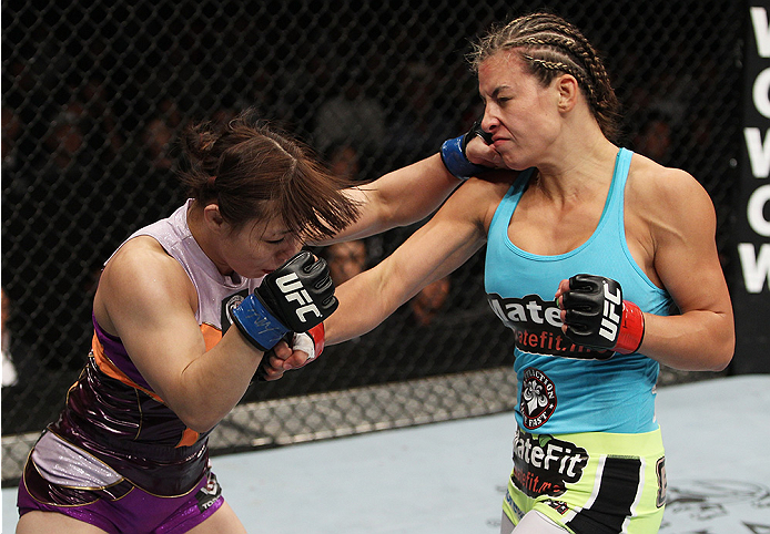 SAITAMA, JAPAN - SEPTEMBER 20: (L to R) Rin Nakai and Miesha Tate exchange punches  in their bantamweight bout during the UFC Fight Night event inside the Saitama Arena on September 20, 2014 in Saitama, Japan. (Photo by Mitch Viquez/Zuffa LLC/Zuffa LLC vi