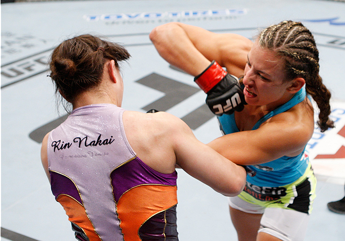 SAITAMA, JAPAN - SEPTEMBER 20:  Miesha Tate throws an elbow at Rin Nakai in their bantamweight bout during the UFC Fight Night event inside the Saitama Arena on September 20, 2014 in Saitama, Japan. (Photo by Mitch Viquez/Zuffa LLC/Zuffa LLC via Getty Ima