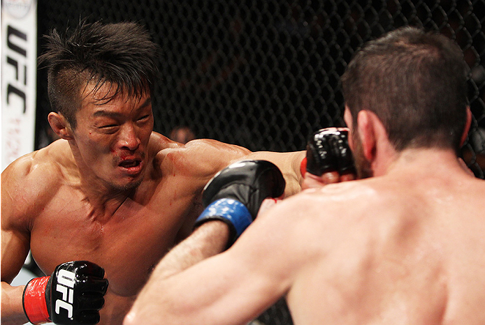 SAITAMA, JAPAN - SEPTEMBER 20:  Yoshihiro Akiyama throws a punch at Amir Sadollah in their welterweight bout during the UFC Fight Night event inside the Saitama Arena on September 20, 2014 in Saitama, Japan. (Photo by Mitch Viquez/Zuffa LLC/Zuffa LLC via